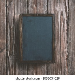 Chalkboard over wooden desk mockup. Top view