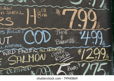 Chalkboard shows the prices of the day's fish catch outside a market in Portland, Maine.