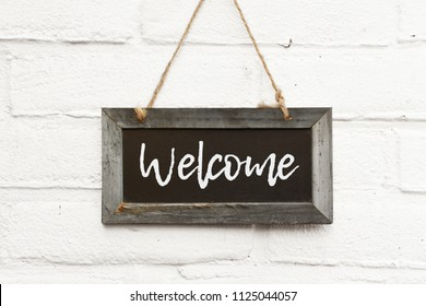 Chalkboard sign board with text welcome come in
