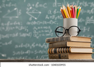Chalkboard with stack book