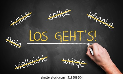 """chalkboard with stroked words like could and should and """"Let's go"""" in the middle in German"""