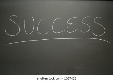 Chalkboard with success written