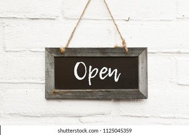 Chalkboard text welcome come in we're open