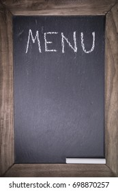 chalkboard with wooden frame for restaurant with written text menu layout template background