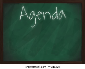 Chalkboard with wooden frame and the text Agenda