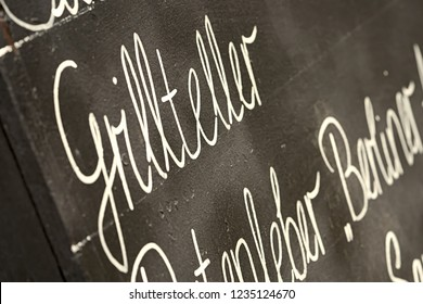 Chalkboard with the word mixed Grill in front of a restaurant in Leipzig