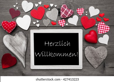 Chalkbord With Many Red Hearts, Willkommen Means Welcome