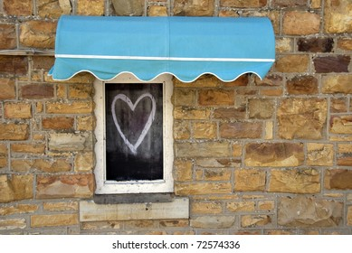 A chalked heart on a window shutter in South Africa. Love is blind.
