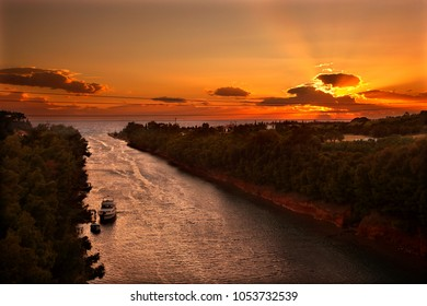 "CHALKIDIKI, MACEDONIA, GREECE.  Sunset at the Canal of Nea Poteidaea (""Potidea"") , Kassandra peninsula."