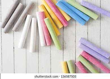 chalks on white wooden table