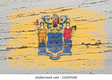 Chalky american state of new jersey flag precisely painted with color chalk on grunge wooden texture