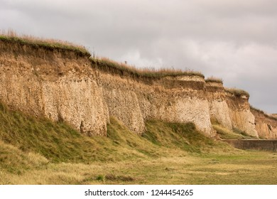 Chalky cliffs by the coast on a bleak and windy day in the winter in the UK.