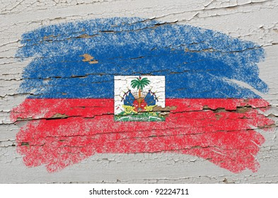 Chalky haitian flag painted with color chalk on grunge wooden texture