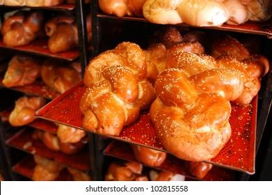 Challah Sabbath bread on display in bakery shop.