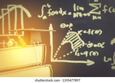 Challenge based learning, experiential learning, education concept : Ladder, black graduation cap, certificate or diploma on books, depicts gaining in-dept subject area knowledge and develop skills.