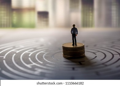 Challenge, Success and Business Vision Concept. present by Miniature Figure of Businessman standing on Money Coin Stack at the center of Maze with Looking Forward posture