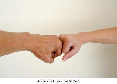 Challenge of two fists of a man and a woman