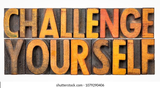 challenge yourself - isolated word abstract in vintage letterpress printing blocks