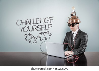 Challenge yourself text with vintage businessman using laptop
