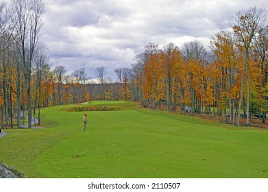 A challenging golf course hole on a stormy autumn day.