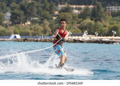 CHALLITHEA, GREECE- MAY 26, 2014: Unidentified man doing water ski on the sea in Kallithea, Greece. -