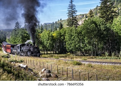 Chama NM, USA, Sept. 19, 2017: A vintage steam locomoitve from the Cumbres & Toltec railroad climbs toward Chama Pass in early autumn.