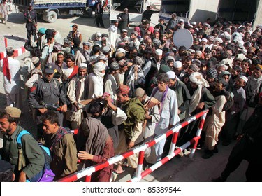 CHAMAN, PAKISTAN - SEPT 25: Security officials stand alert while Afghan nationals are handing over to Afghan authorities through Friendship Gate at Pak-Afghan border on September 25, 2011in Chaman .
