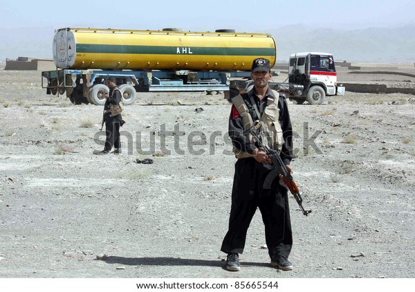 CHAMAN, PAKISTAN - SEPT 29: FC officials surround an explosive material loaded NATO oil-tanker which was transported fuel to NATO forces in Afghanistan on September 29, 2011in Chaman.