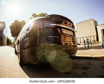 CHAMBERY, FRANCE - AUG 15, 2017: Wide angle lens fish-eye over luxury Tesla Model X electric car SUV parked on French street on a sunny day - rear view of the car