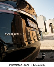 CHAMBERY, FRANCE - AUG 15, 2017: Wide angle lens fish-eye over luxury Tesla Model X electric car SUV parked on French street on a sunny day - square image