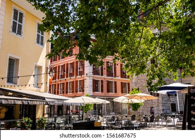 CHAMBERY; Auvergne-Rhône-Alps; SAVOY; FRANCE - July 7, 2019: View of restaurant tables in the historic center, in summer.