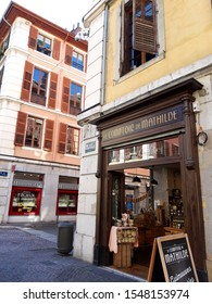 Chambery/France-October 11,2019: city historical center street facade houses shops view architecture building Chambery tourism travel french alps mountain savoie france region vertical image