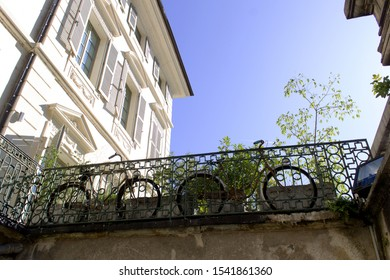 Chambery/France-October 11,2019:Place du Chateau ancien french architecture detail building city facade with garden and bicycle sightseeing tourism travel alp savoie france region chambery