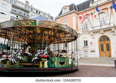 Chambery/France-October 23,2019:P city historical center facade view architecture building with vintage carousel of hourses Chambery tourism travel french alps mountain savoie france region