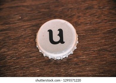 Chambly, Quebec, Canada - JAN 14, 2019: Unibroue Brewery beer bottle cap on wood table. Canadian beer maker based in Chambly, Quebec.