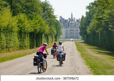 Chambord , France - CIRCA August, 2015  - Bikers bicycle touring with pannier near Chambord Castle in France, Loire Valley