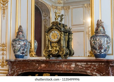 CHAMBORD, FRANCE - June 14, 2018: Antique mantel clock and vases in Château de Chambord in the Loire Valley of France
