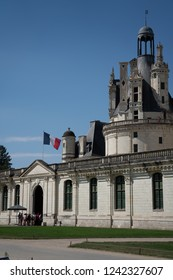 Chambord / France - September 9, 2018: Chateau Chambord entrance with French flag.