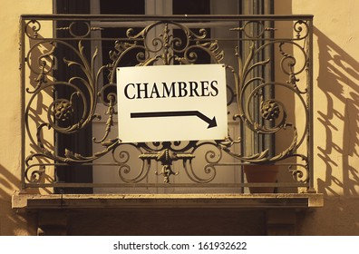 Chambres (rooms to rent) or accomodation sign on an ornate balcony in Collioure, France.