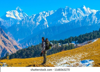 Chamoli India - Jan 1,2017 : Hiker enjoying the view of Himalayas Moutains