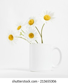 Chamomile flower in a mug on a white background