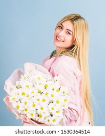 Chamomile flower symbol of innocence and tenderness. Celebrating her special day. Surprise for girlfriend. Adore flowers. Girl tender sensual blonde hold flowers bouquet. Flowers delivery service.