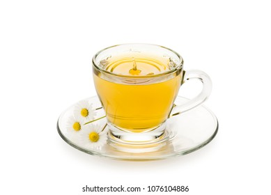 chamomile in glass cup with splashing drop and daisy on white background