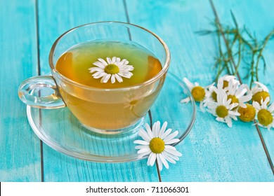 Chamomile tea. Camomile flower and cup of camomile tea.