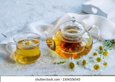 Chamomile tea in a glass teapot