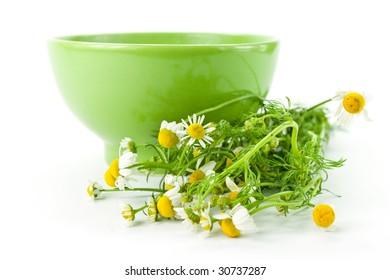 chamomile tea on the white background