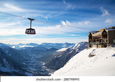 Chamonix, France - January , 28, 2015: Cable Car from Chamonix to the summit of the Aiguille du Midi  and stanning panoramic view of the mountains and town of Chamonix, France.