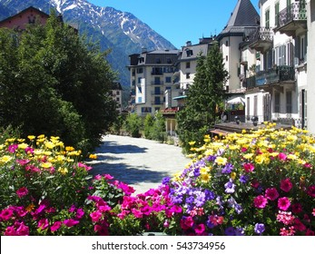 CHAMONIX MONT BLANC village with high alpine mountains range in french ALPS landscapes with colorful flowers at Arve river in FRANCE and clear blue sky in 2016 warm sunny summer day, EUROPE on July.