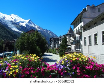 CHAMONIX MONT BLANC village with high alpine mountains range in french ALPS landscape with colorful flowers at Arve river in FRANCE with clear blue sky in warm sunny summer day, EUROPE on JULY 2016.