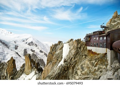 Chamonix Mont-Blanc, France - July 19, 2017: Travelers enjoying Alpine panorama, Famous Tower Aiguille du Midi 3842m. Mont Blanc Massif